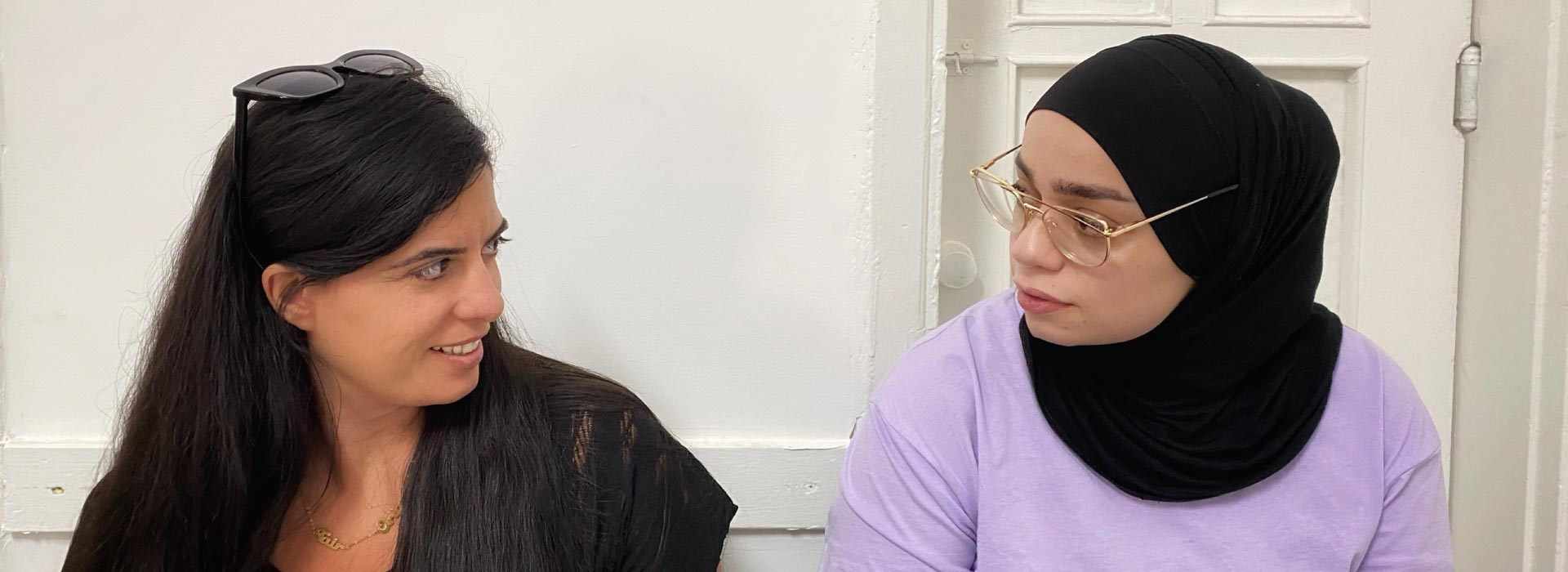 Two women looking at each other