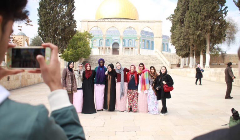 A picture of a group in front of the Dome of the Rock