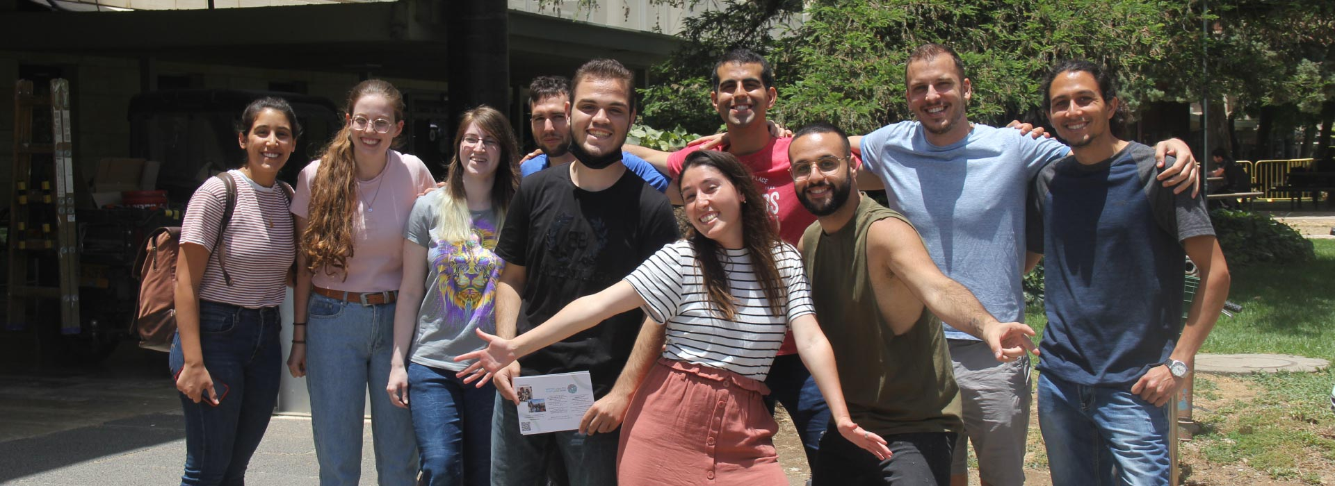 A group of students and their facilitators outside in the Givat Ram campus